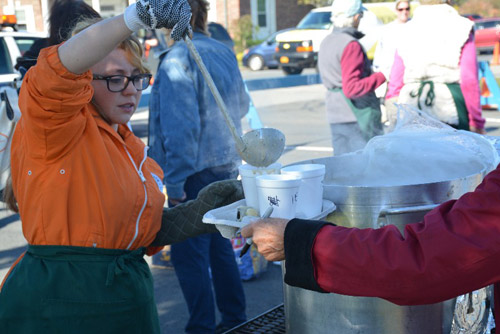 One of the many who volunteered to serve the Clam Chowder, Emily Havlik.