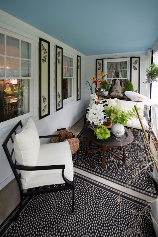 Christine McCabe Designs set the front porch with inviting seating and outdoor area rugs.