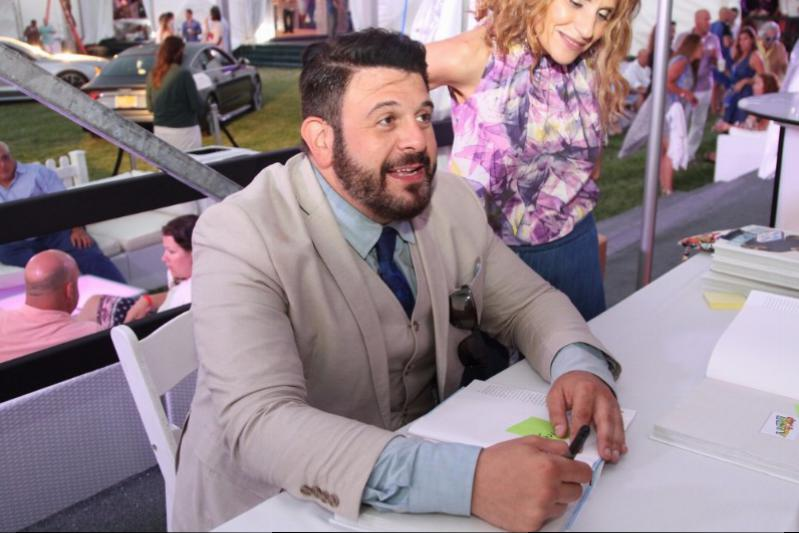Adam Richman signing his book in the VIP lounge at Grillhampton