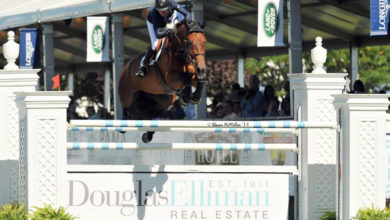 Molly Ashe-Cawley rode Carissimo to victory in the $50,000 Douglas Elliman Grand Prix Qualifier, presented by Longines at the Hampton Classic
