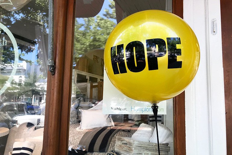 Week of Hope yellow balloon in front of Hildreth's in Southampton