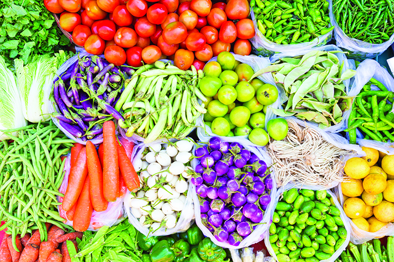 44288321 - farmers market with various domestic colorful fresh fruits and vegetable. tasty colorful mix.