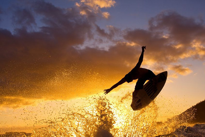 Sunset surfer gets air