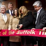 Theater owners Diane and Bob Castaldi cut the ribbon to the Suffolk Theater in downtown Riverhead