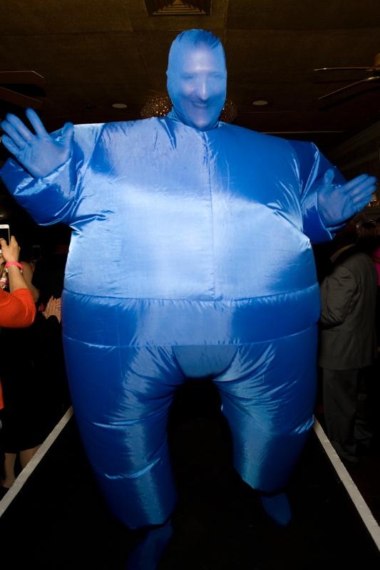 Escort Dr. Jim Brady in a blue man suit.