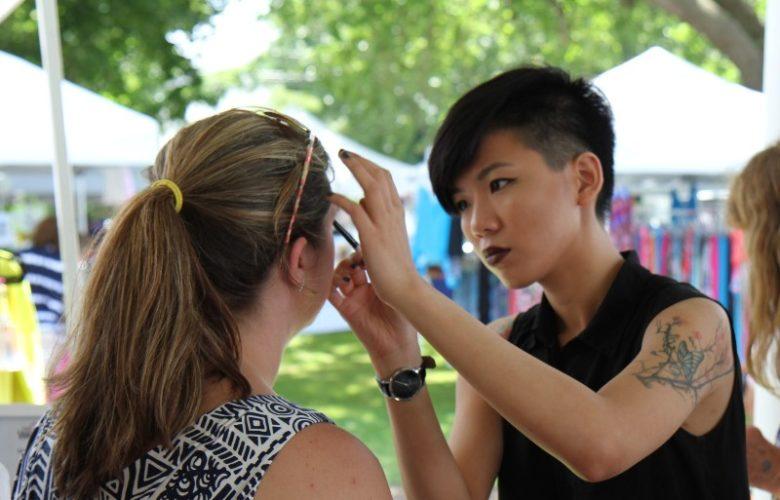 "Make Up Pro"" Artist Crystal applies make up to Lindsey during the promotion of the Fox Entertainment movie ""The Other Woman""."