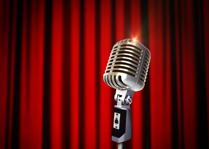 Vintage Microphone over Red Curtains live events