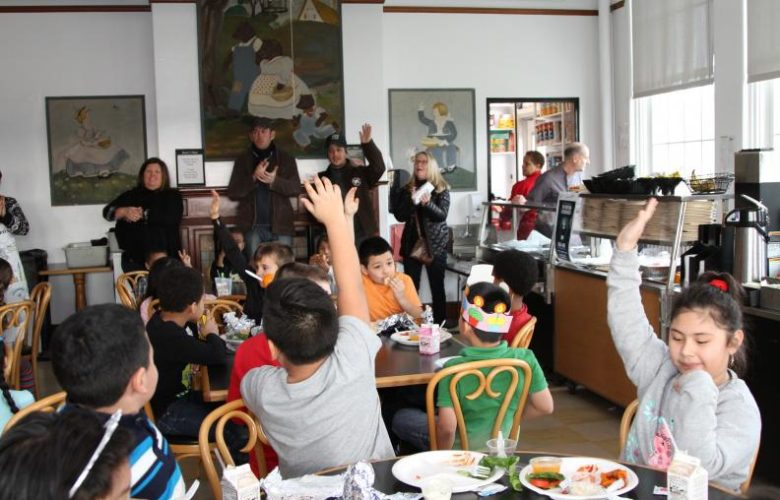 Chef Jason Weiner and Sean Barrett led the students in a fishburger cheer as they introduce the Montauk Fishburger to them