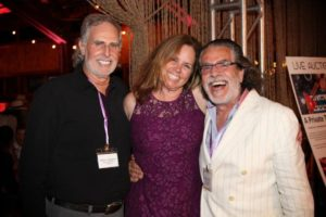 Steven J Bergerson, past president of The Retreat Nicole Behrens, and current president Richard Demato of RJD Gallery