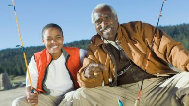 Smiling Grandfather and Grandson Fishing