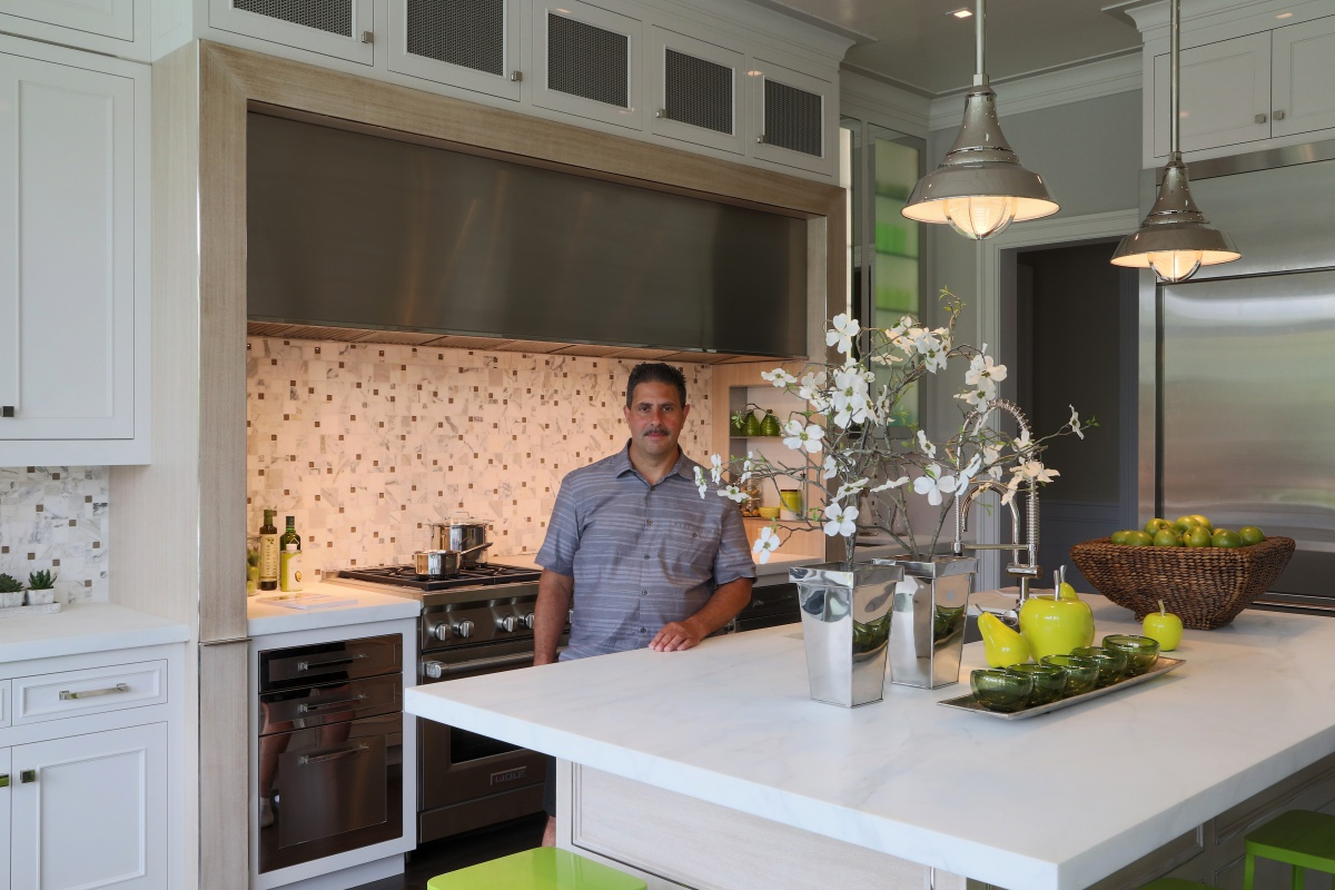 Gary Ciuffo of Ciuffo Cabinetry stands in the kitchen his firm designed for the Hampton Designer Showhouse.
