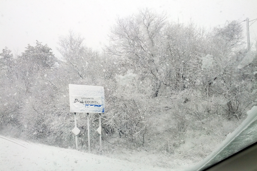 The snow covered Dan's Country sign near Exit 68 on 495 Monday morning