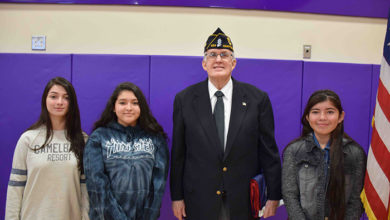 Matthew Dwyer at his ceremony on Friday, January 27. He is pictured with Hampton Bays High School VFW Patriot's Pen essayists Alisia Soto, Alexa Armas and Melissa Gruzman