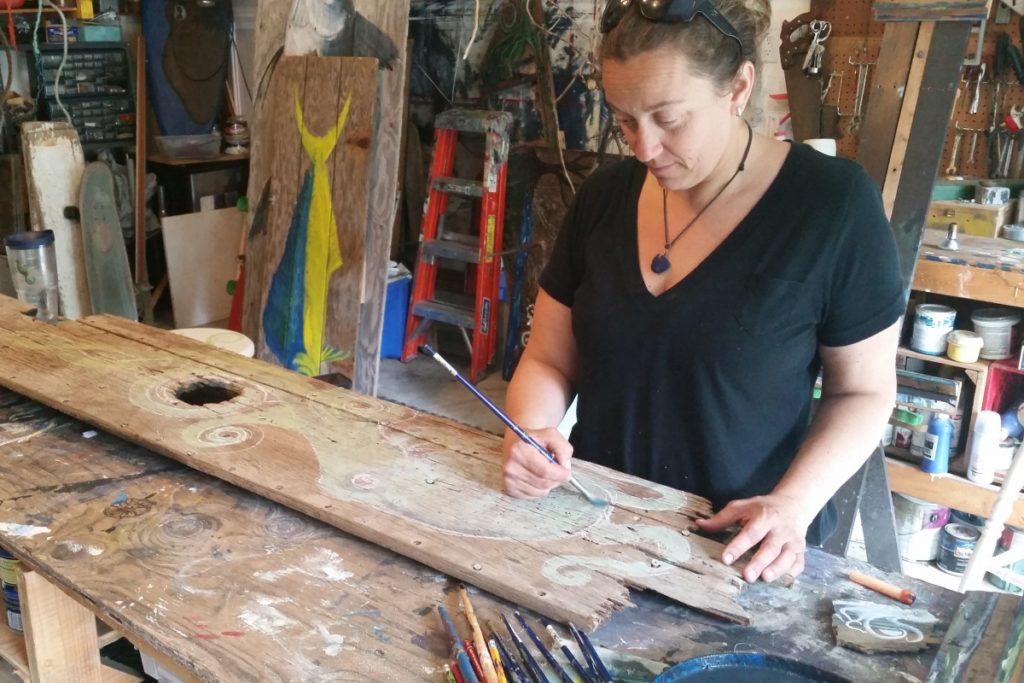 Artist Carolyn Munaco at work in her home studio in Hampton Bays.