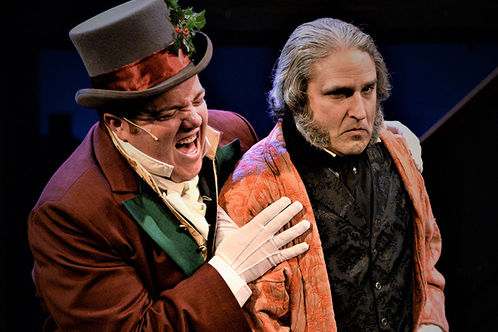 "Bobby Montaniz as Christmas Present with Jeffery Sanzel as Scrooge in ""A Christmas Carol"" at Theatre Three"