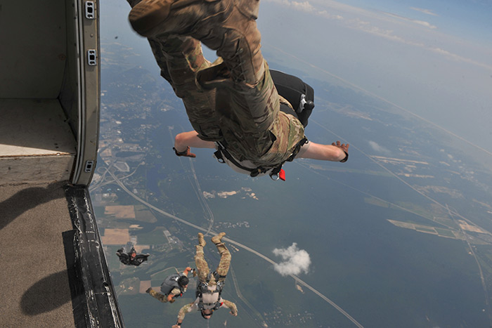 Members of the 103rd Rescue Squadron conduct canopy control training at Calverton Airport