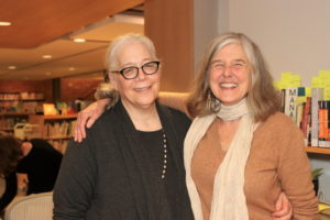 John Jermain Memorial Library Circulation Desk and exhibition curator Susan Blumenkrantz, JJML Director Cathy Creedon