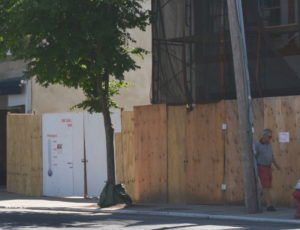 The Sag Harbor Cinema Arts Center will rise up from behind these plywood walls