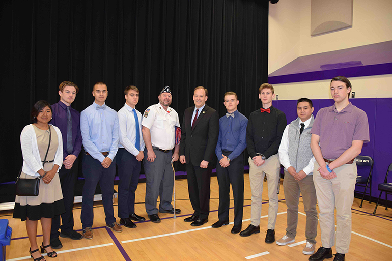 Daniel Stebbins with Lee Zeldin and Hampton Bays students, Photo: Courtesy Syntax