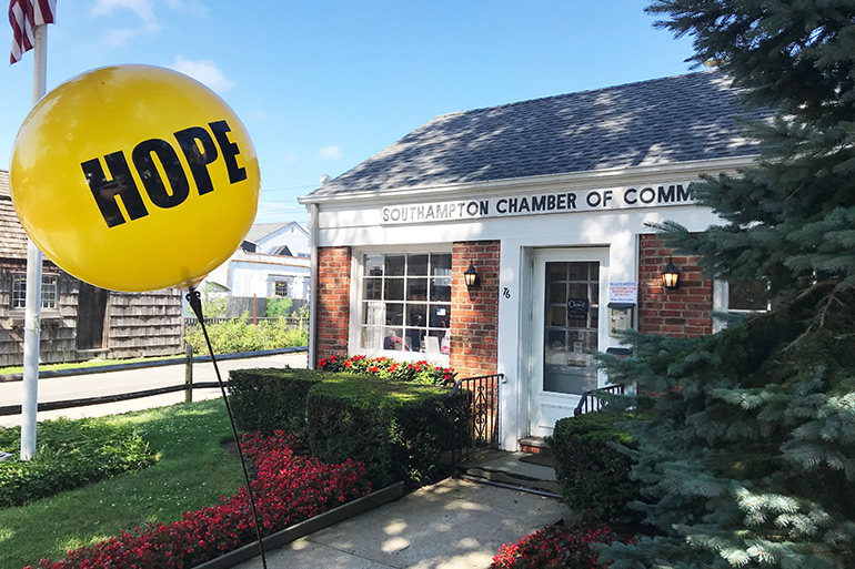 Week of Hope yellow balloon in front of the Southampton Chamber of Commerce