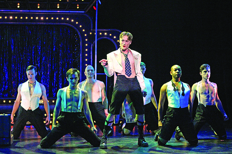 """Josh Canfield as the """"Cabaret"""" emcee with the Kit Kat Boys, Photo: Jeff Bellante"""