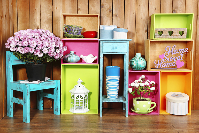 35872956 - beautiful colorful shelves with different home related objects on wooden wall background