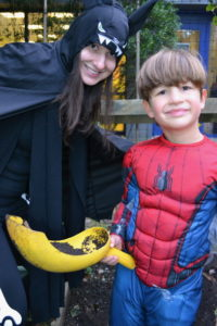 Bat Mom, Sarah Mesler with her Spider-Man son, 4 year old Lev spending time together outdoors during the Halloween bash