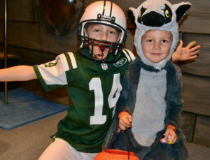 Jets fan Brennan, 7 years old, and his brother, Bryce, 4, as a lemur