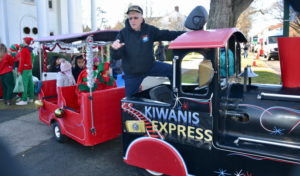 All aboard the Train Express with conductor, Henry Uihlein Jr.