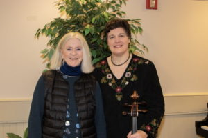 Director of Adult Programs at Rogers Memorial Library Penelope Wright and cellist Suzanne Mueller