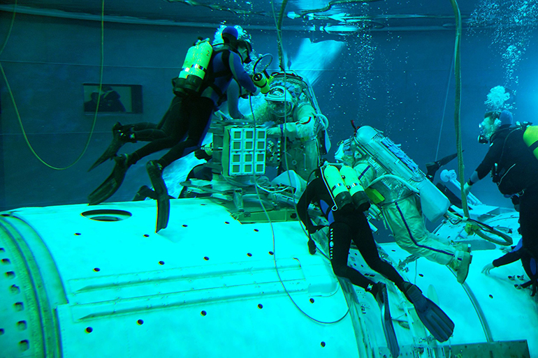 Astronauts pool training for the International Space Station, ISS