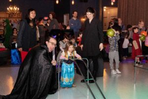 Dr. Joel Hoffman, Director of Education at Jewish Center of the Hamptons cheers as kids bowl