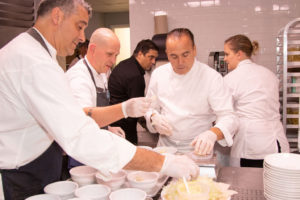Chefs Joe Realmuto, Drew Hiatt, Jean-Georges Vongerichten in the kitchen