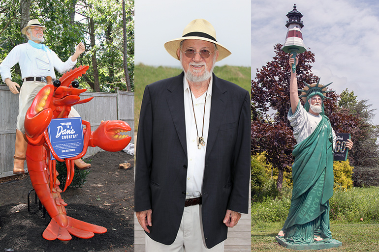 Dan and his statues, one with him riding a lobster, the other with him as the Statue of Liberty