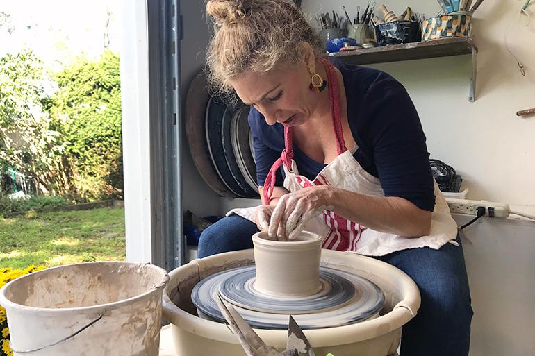 Eve Behar on the potter's wheel
