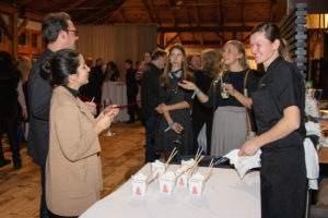 Chef Jennilee Morris greets guests during cocktail hour