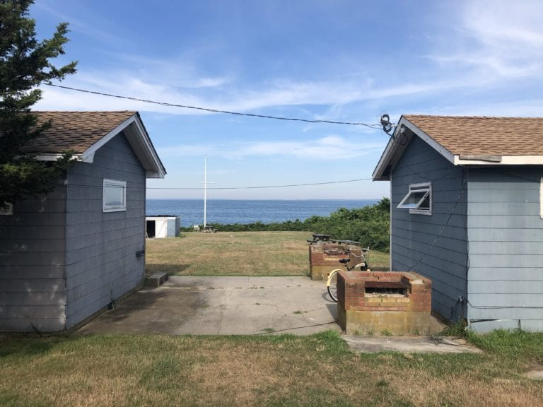 FOUR RAMSHACKLE COTTAGES WITH AN UNOBSTRUCTED VIEW OF FORT POND BAY WILL SOON BE REPLACED BY FOUR HIGH-END RESORT UNITS.