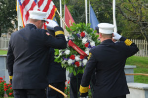 FIRE CHIEFS SALUTE AT THE EAST HAMPTON 9/11 MEMORIAL IN 2019. PHOTO BYRICHARD LEWIN