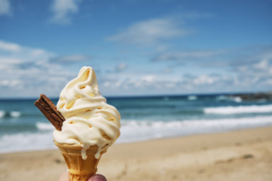 melting Ice cream at Fistral beach, Newquay, Cornwall on a bright sunny June day.